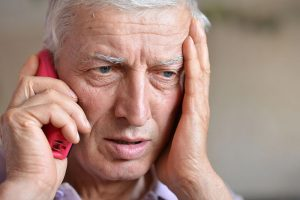 Elderly-worried-man-phone