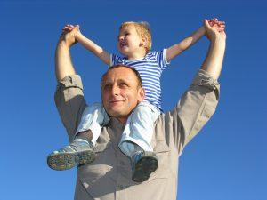 man-w-grandson-on-shoulders